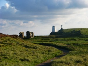 LLanddwyn Island, lighthouse, church and cross. Anglesey and Snowdonia